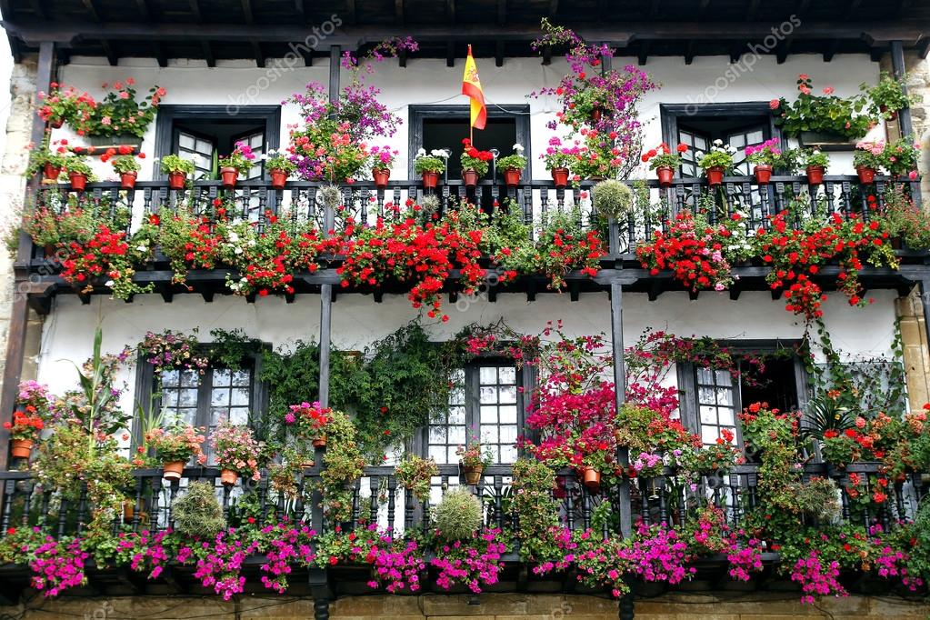 beautiful balcony with flowers of an old spanish town house stock photo agafapaperiapunta. Black Bedroom Furniture Sets. Home Design Ideas