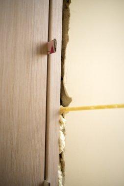Installation of doors using polyurethane foam mounting.