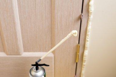 Installation of doors using polyurethane foam mounting. Cylinder Foam