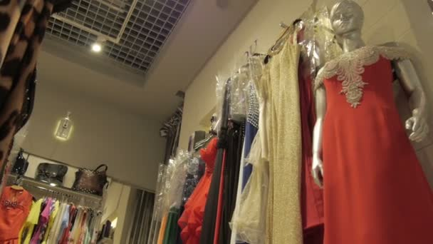 Clothing Hanging on Hangers at Clothes Shop during Opening New Collections