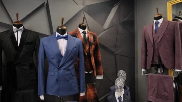 Luxury men fashion suits displaying on mannequins at store