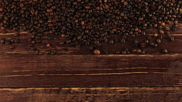 Young man puts a cup of coffee beside arranged roasted black coffee beans on brown wooden table