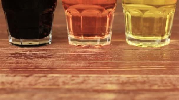 Pomegranate juice, raspberry juice and grape juice on wooden table