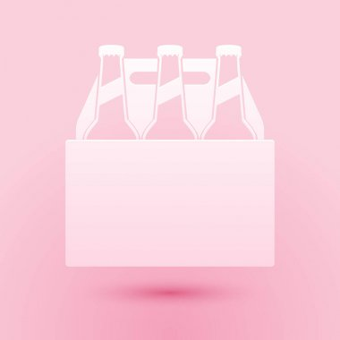 Paper cut Pack of beer bottles icon isolated on pink background. Case crate beer box sign. Paper art style. Vector. icon