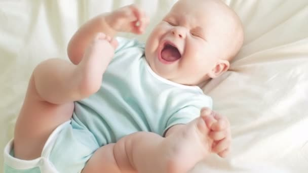 joyful baby in bed