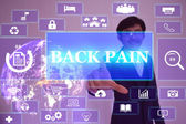 BACK PAIN  concept  presented by  businessman touching on  virtu