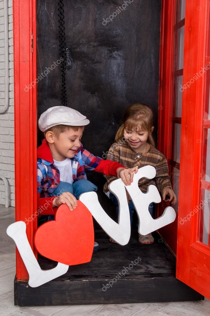 Boy and girl in the phone booth