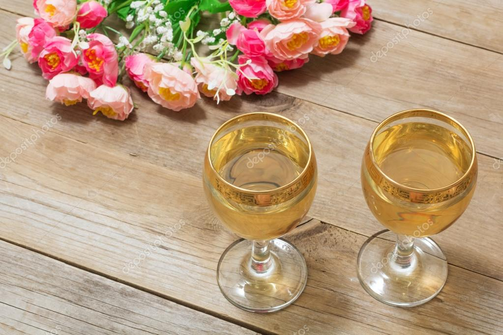 Two glasses of white wine and flowers stock photo monochromst two glasses of white wine and flowers stock photo mightylinksfo