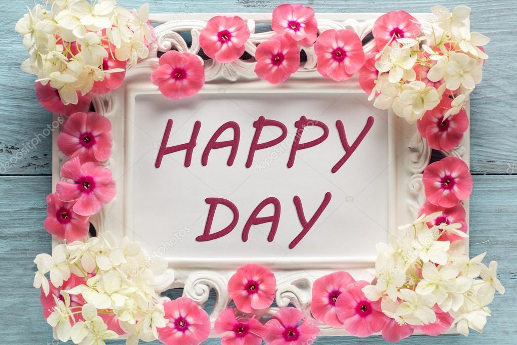 Bildunterschrift: glücklicher Tag, umrahmt von Blumen — Stockfoto ...