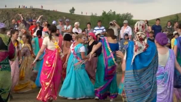 Magnitogorsk/russia .holiday Krishna Reserve Arkaim. . June 21 2016. Women in Indian Sari Dress Dancing in the Meadow.