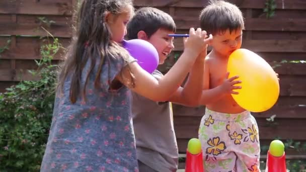 Balloon bursting, the boy cries