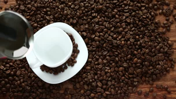 Pouring coffee in cup surrounded by coffee beans