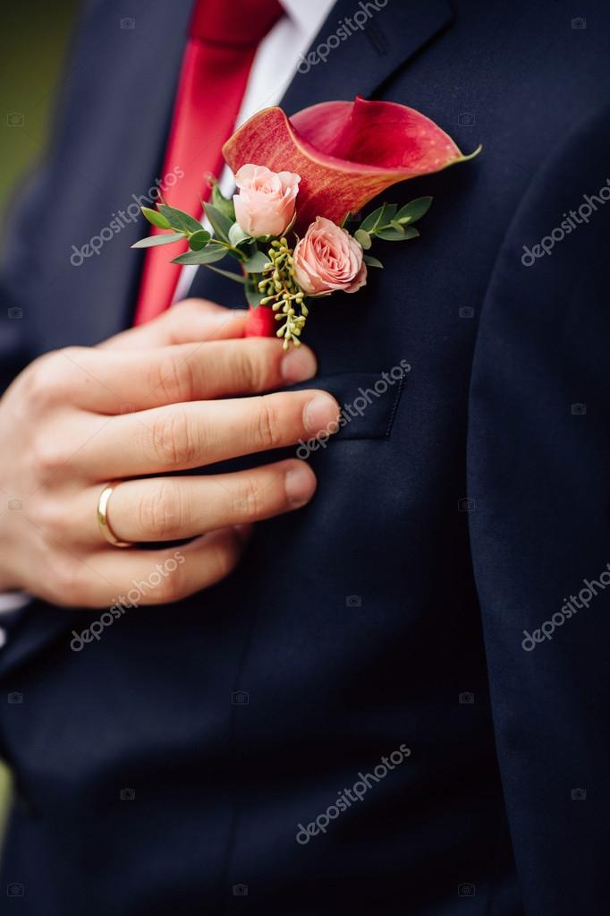 Groom with flower - groom boutonniere