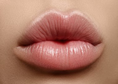 Sweet kiss. Perfect natural lip makeup. Close up macro photo with beautiful female mouth. Plump full lips. Close-up face detail. Perfect clean skin, light fresh lip make-up. Beautiful spa tender lip
