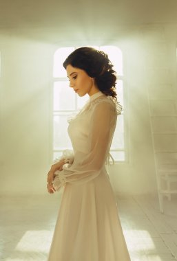 Lady in white vintage dress