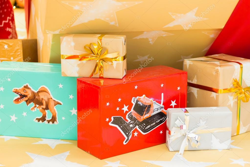 Christmas presents on festive lighted background