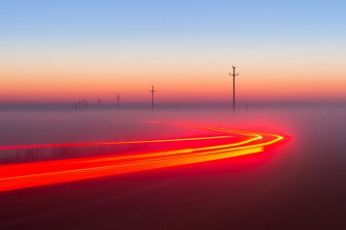 Long Exposure Red Car light trails on a road