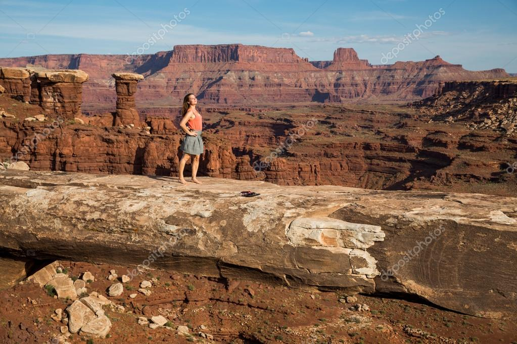 Girl on Muscleman Arch, Canyonlands National Park