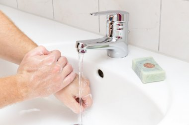 Man washing hands with soap