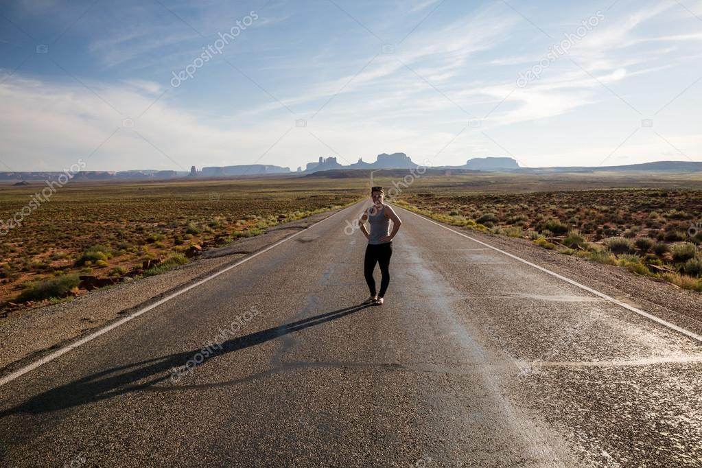 Girl on the road near Monument Valley