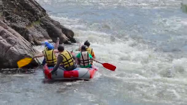 Group rafting on the turbulent mountain river