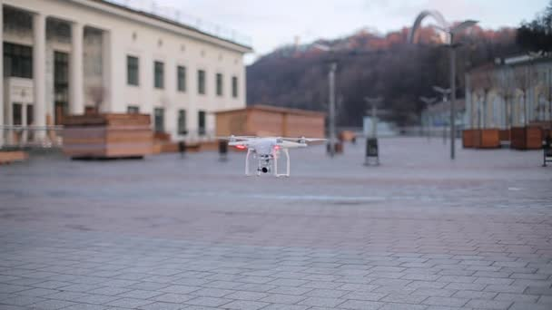 Aerial drone rises above the ground