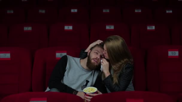 Guy with a girl crying in the cinema