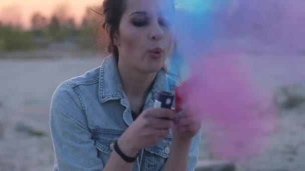 Girl inflates colored smoke bombs
