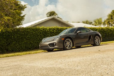 Full shot Porsche Cayman. Urban scene.