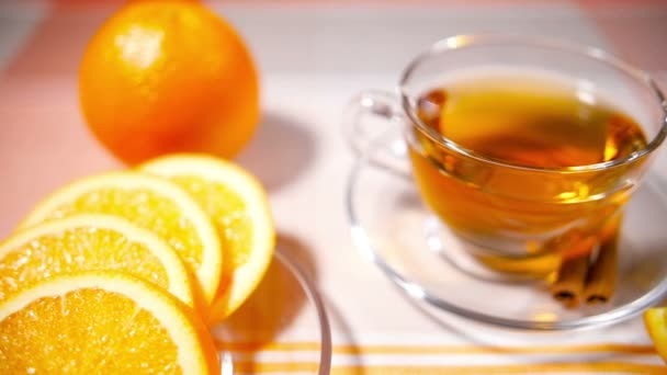 Cup of Tea, Glass Teapot, Oranges on a Tablecloth