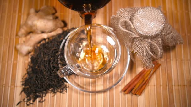 Pouring Tea with Scattered Tea, Honey, Ginger and Cinnamon