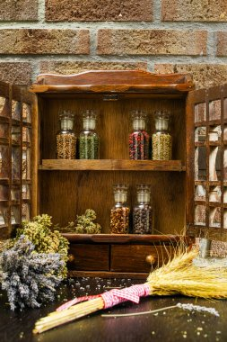 Vintage Wooden Spice Rack Or Storage Cabinet And Six Glass Bottles
