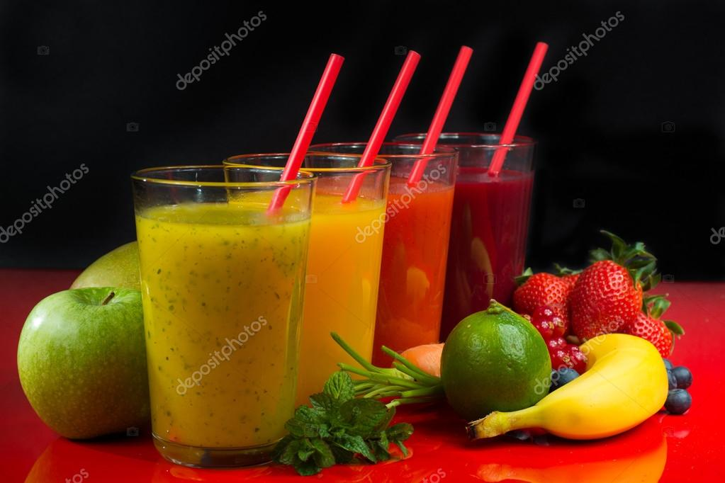 colofrul fresh pressed fruit juices in tall glasses with fruits