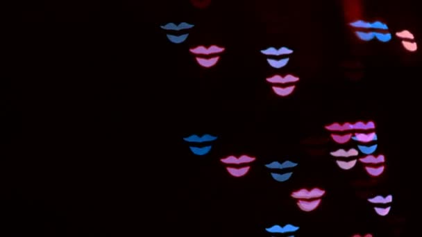 Glowing Figures in the Shape of Lips and Kiss