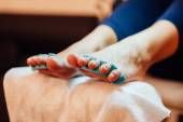 Fotografie Master pedicure nails and cuticles closeup .