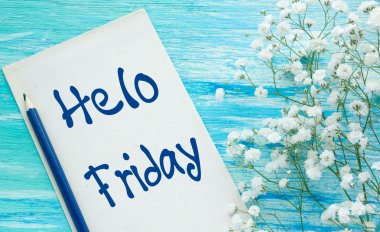 Hello Friday inspirational quotes lettering for postcards, business ideas, announcements, write a note with beautiful handwriting of a female hand notebook. wooden background