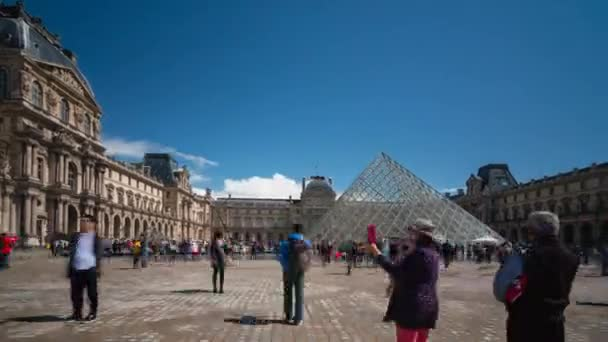 Tourists at The Louvre Pyramid