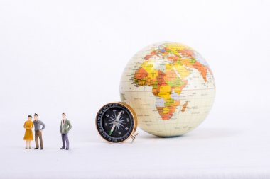A couple by the side of a globe