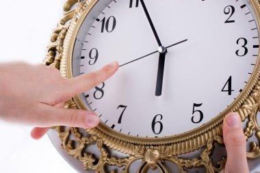hands touching clock closeup