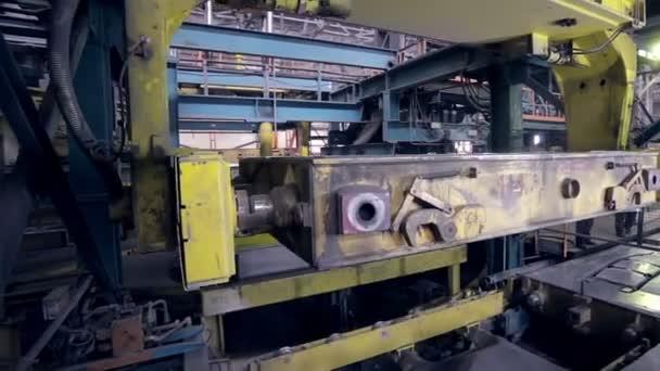 Robot making car parts at factory. Automative metal casting.