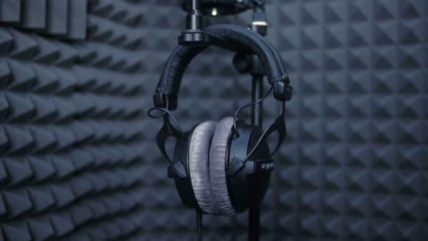 Photo Studio headphones microphone in professional sound studio.