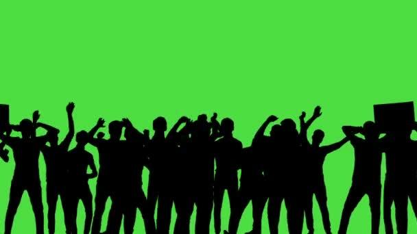 eine Menge tanzender Menschen, alle in Silhouette, auf einem Greenscreen.