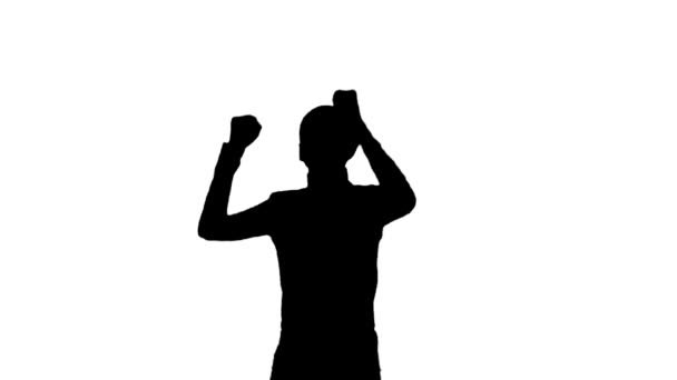 Silhouette of man dancing.