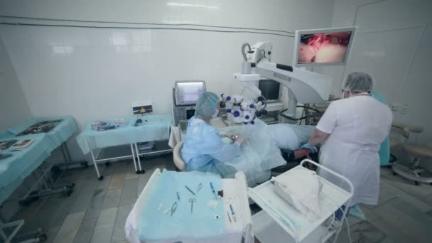 Unrecognizable Doctors team performing surgery in hospital operating room.