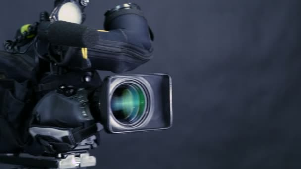 Movement along professional studio camera, camcoder standing in TV studio ready for broadcasting.