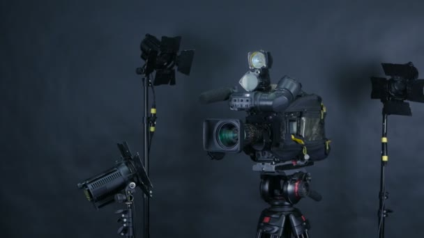 Camcorder, video camera and professional studio lights in a broadcasting studio.
