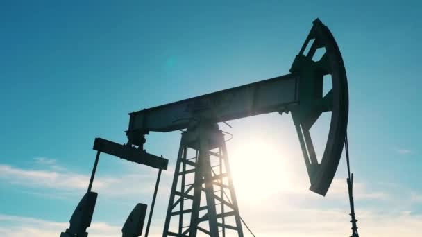 Closeup of oil pumpjack at oil field on a sunny day