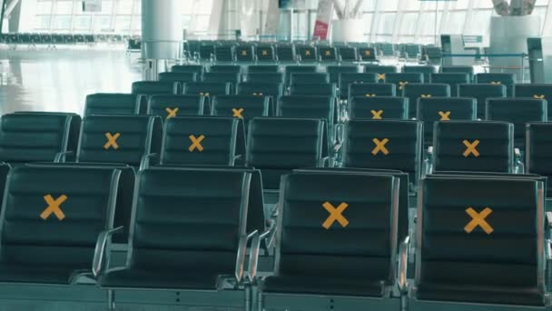 Seats at the airport marked for social distancing. Empty airport terminal, no people. Pandemic, covid-19 lockdown concept.
