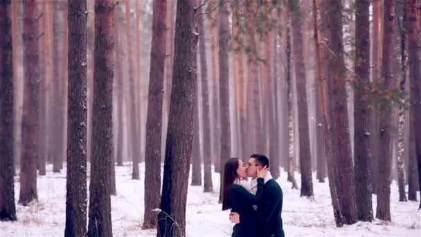 Young lovers, couple having fun in a winter forest.