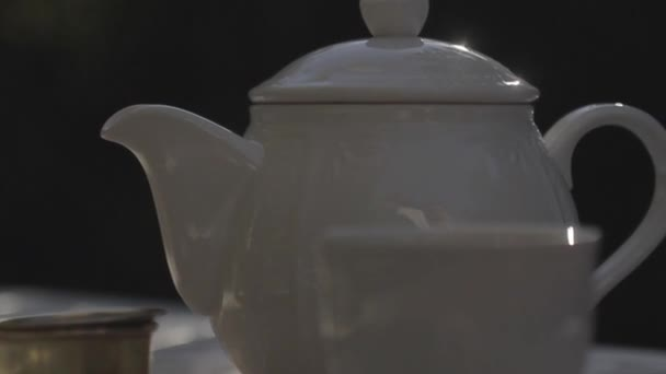 Hot tea in a white teapot